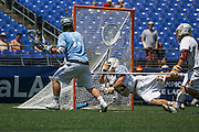 05/25/2014 - Baltimore, Md. - Tufts attack John Uppgren, A16, scores on Salisbury goalkeeper Alex Taylor in Tufts' 12-9 win over Salisbury to win the NCAA Division III Men's Lacrosse National Championship game at M&T Bank Stadium on May 25, 2014. (Kelvin Ma/Tufts University)