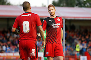 Matt Harrold pleads with Jimmy Smith to take the penalty during the Pre-Season Friendly match between Crawley Town and Brighton and Hove Albion at the Checkatrade.com Stadium, Crawley, England on 22 July 2015. Photo by Michael Hulf.