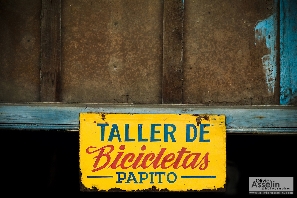 "Sign reading ""Papito's bicycle workshop"" in Baracoa, Cuba on Monday July 14, 2008."
