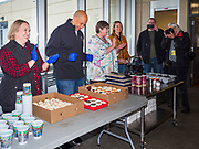 27 NOVEMBER 2019 - DES MOINES, IOWA: US Senator CORY BOOKER (D-NJ) gets ready to help serve dessert at Central Iowa Shelter and Services in Des Moines. Sen Booker helped plate up and serve lunch at the shelter. The shelter has about 180 beds and is full almost every night. In January and February, more than 250 people per night come to the shelter, which sets out overflow bedding. Senator Booker is running to be the Democratic nominee for the US Presidency in 2020. Iowa hosts the first selection event of the presidential election season. The Iowa caucuses are February 3, 2020.       PHOTO BY JACK KURTZ