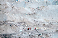 Hikers trek across the ice fields of Mendenhall Glacier just outside of Juneau, AK Sept 2, 2009. Photo Ken Cedeno