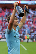 Manchester City Defender John Stones (5) celebrating after win during the FA Community Shield match between Chelsea and Manchester City at Wembley Stadium, London, England on 5 August 2018.