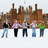 LONDON - NOVEMBER 28: Members of  The Philharmonia Orchestra play a Christmas carol on the temporary ice rink set up in the grounds of Hampton Court Palace on November 28, 2008. The ice rink, which officially opens tomorrow and runs until January 11, 2009, is set against the backdrop of King Henry VIII's Tudor Palace....Please telephone : +44 (0)845 0506211 for usage fees .***Licence Fee's Apply To All Image Use***.*Unbylined uses will incur an additional discretionary fee!*.XianPix Pictures  Agency  tel +44 (0) 845 050 6211 e-mail sales@xianpix.com www.xianpix.com