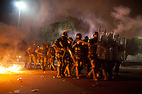 Special elite police forces, BOPE, shoot smoke bombs, tear gas and rubber bullets at protestors in downtown Rio de Janeiro, Brazil, on Thursday, June 20, 2013. <br /> <br /> About 300,000 Cariocas (residents of Rio de Janeiro) against the government, which began with a 20-cent hike in public transport fares, and moved to widespread frustration about a heavy tax burden, corrupt politicians and weak public education, health and transport systems, as the nation hosts the Confederations Cup soccer tournament and prepares for next month's papal visit. <br /> <br /> The demonstrations came despite the government's U-turn over public transport fare hikes which sparked the protests over a week ago.
