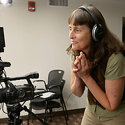 Leah Lamb readies her camera for a delegate interview at the International Women's Earth and Climate Summit. Leaders from 35+ countries gathered for the drafting of a Women's Climate Action Agenda in Suffern, New York September 20-23rd, 2013 as part of the International Women's Earth and Climate Summit.  For a full list of Summit delegates and an agenda visit www.iweci.org. Photo by Lori Waselchuk/Magazines OUT