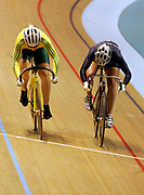 (L-R) Kerrie Meares (AUS) and Elisabeth Williams (NZL) compete in the Women's Cycling Track Sprint during the XVIII Commonwealth Games, at the Multi Purpose Arena, Melbourne, Australia, on Saturday 18 March, 2006. Photo: Sport the Library / www.photosport.nz