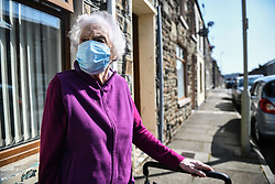 © Licensed to London News Pictures. 17/09/2020. Rhondda Valley, UK. Local resident, Pauline Warman aged 89 pictured wearing her mask whilst out in the town of Treorchy in the Rhondda Valley which will go into local lockdown today after a spike in the coronavirus infection rate in the borough of Rhondda Cynon Taff in south Wales.. Photo credit: Robert Melen/LNP