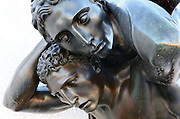 Detail of a bronze statue of wrestlers at the Stadio dei Marmi or Stadium of the Marbles, a stadium designed c. 1928 by Enrico Del Debbio and inaugurated 1932, at the Foro Italico, Rome, Italy. The stadium has Carrara marble steps lined by 59 marble statues of athletes in classical style. The Foro Italico or Foro Mussolini is a sports complex built 1928-38 in Fascist style by Enrico Del Debbio and Luigi Moretti, inspired by Roman forums. Fascist architecture developed in the late 1920s and 1930s, as a modernist style in times of nationalism and totalitarianism under Benito Mussolini. It is characterised by large, square, symmetrical buildings with little or no decoration, often inspired by ancient Rome and designed to convey strength and power. Picture by Manuel Cohen