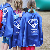 The first 100 children who signed up for Saturday's CASA Superhero run recieved a superhero cape