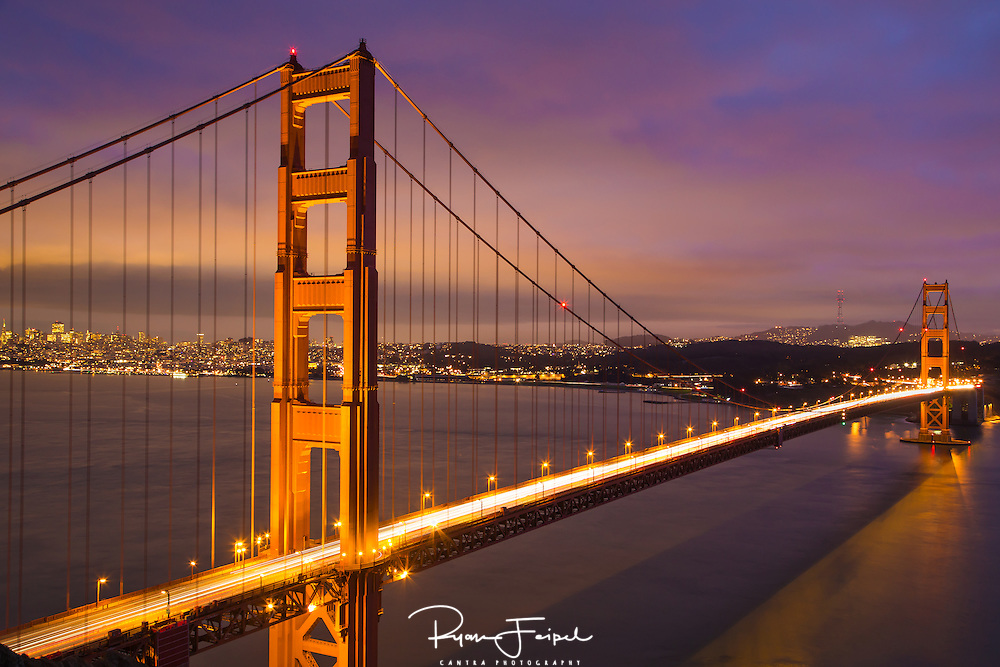 With the ever changing weather patters in the San Francisco bay area I had to seize the opportunity to capture the Golden Gate Bridge.  I spent the better part of the afternoon checking all vantage points along the hillside.  I wanted to show as much detail across the entire frame.  Typically called the blue hour, this is the period of twilight during dusk when the sun is well below the horizon and the residual light takes on a predominantly blue hue.  With that and the city lights casting more colors this photo was well worth the wait.