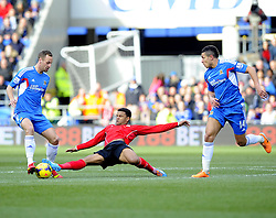 Cardiff City's Fraizer Campbell stretches for the ball with Hull City's David Meyler and Hull City's Jake Livermore - Photo mandatory by-line: Joe Meredith/JMP - Tel: Mobile: 07966 386802 22/02/2014 - SPORT - FOOTBALL - Cardiff - Cardiff City Stadium - Cardiff City v Hull City - Barclays Premier League