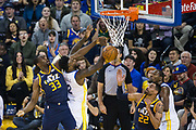 Utah Jazz center Ekpe Udoh (33) blocks a shot by Golden State Warriors forward Jordan Bell (2) at Oracle Arena in Oakland, Calif., on December 27, 2017. (Stan Olszewski/Special to S.F. Examiner)