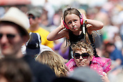 A young girl wears ear defenders as she listens to Stornoway on the main stage during day two of the Isle of Wight Festival 2011 at Seaclose Park on June 11, 2011 in Newport, Isle of Wight.  (Photo by Simone Joyner)