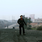 Wangjiazhai, a village of coal miners.  Coal seems to be everywhere, on the roads, on the colour of the houses, on people.