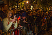 New York, NY, October 31, 2013. A crown lining Sixth Avenue to watch the Greenwich Village Halloween Parade.