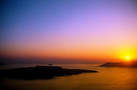 Looking from Fira, the island of Santorini, to Nea Kameni (left) and Thirassia (right) at sunset, the Cyclades, Greece