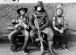 © Licensed to London News Pictures.01/11/15<br /> Whitby, UK. <br /> <br /> Three youngsters wearing steampunk clothing sit on a bench as hundreds of visitors attend the Whitby Goth weekend in Whitby, North Yorkshire. The event began in 1994 to celebrate goth culture and music and takes place twice each year. <br /> Thousands of extravagantly dressed people attend the popular event wearing Steampunk, Cybergoth, Romanticism, Victoriana and other clothing as they take part in the celebration of Goth culture. <br /> <br /> Note to Editors - Picture shot on Kodak Tri X 400ISO film.<br /> Photo credit : Ian Forsyth/LNP