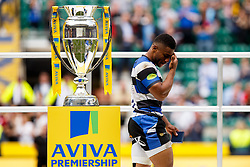 Bath Inside Centre Kyle Eastmond walks dejected past the Aviva Premiership trophy after Saracens win the match - Photo mandatory by-line: Rogan Thomson/JMP - 07966 386802 - 30/05/2015 - SPORT - RUGBY UNION - London, England - Twickenham Stadium - Bath Rugby v Saracens - 2015 Aviva Premiership Final.