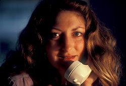 Stock photo of a young woman answering phone calls