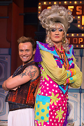"""© Licensed to London News Pictures. 11/12/2012. London, England. L-R: Jon Lee as Aladdin and Lily Savage/Paul O'Grady as the Widow Twankey. Lily Savage, aka Paul O'Grady, stars as the Widow Twankey in the Christmas panto """"Aladdin, A Wish Come True"""" at the Theatre at the O2, O2 Arena, London. Photo credit: Bettina Strenske/LNP"""