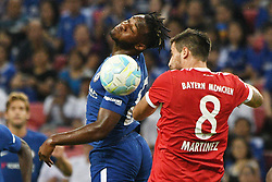 2017?7?25?.??????——?????????????????..7?25????????Michy Batshuayi??????????????????Javier Martinez???.???? ??????..Chelsea's player Michy Batshuayi (L) fights for the ball with Bayern Munich's player Javier Martinez during the International Champions Cup match between Chelsea and Bayern Munich held in Singapore's National Stadium on Jul 25, 2017..By Xinhua, Then Chih Wey..????????????2017?7?25? (Credit Image: © Then Chih Wey/Xinhua via ZUMA Wire)