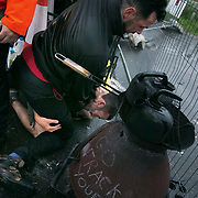 Day two of the Rolling Resistance, Preston New Road, Lancashire. Security violently try to prevent climate protectors to lock-on at the gates to Quadrilla drill site. One activists was restrained by the site manager using pressure points to the neck and throat and pinned to the ground by security staff on the road outside Quadrilla's property. Two activists managed to lock themselves down and block the gates.  A lock-on, where two or more lock themselves together inside a re-inforced tube is used as a peaceful non-violent way protesting. The New Preston Road Quadrilla site is almost ready to start drilling for shale gas after many delays caused by local objections. Lancashire County council voted against fracking but the conservative central government forced it through.ent forced it through.