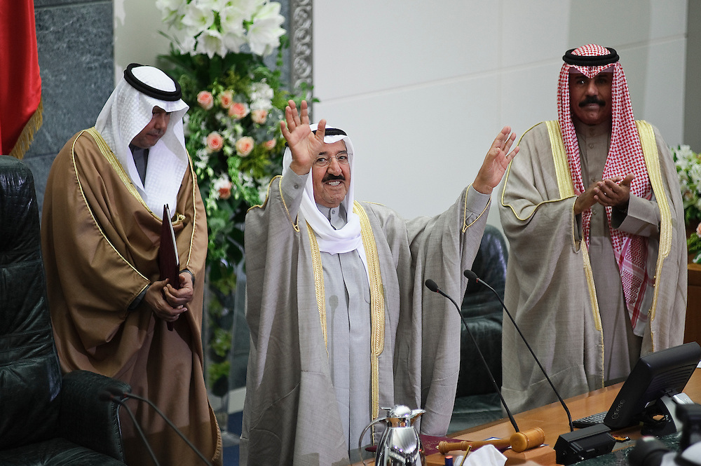 HH the Emir Sheikh Sabah Al-Ahmad Al-Jaber Al-Sabah waves to the crowd inside the National Assembly in Kuwait City Feb. 15, 2012, at the conclusion of the inauguration ceremony of the new parliamentary term. HH the Crown Prince Sheikh Nawaf Al-Ahmad Al-Jaber Al-Sabah stands beside (R of picture). Kuwaitis voted Feb. 2 for a new 50-member legislature.