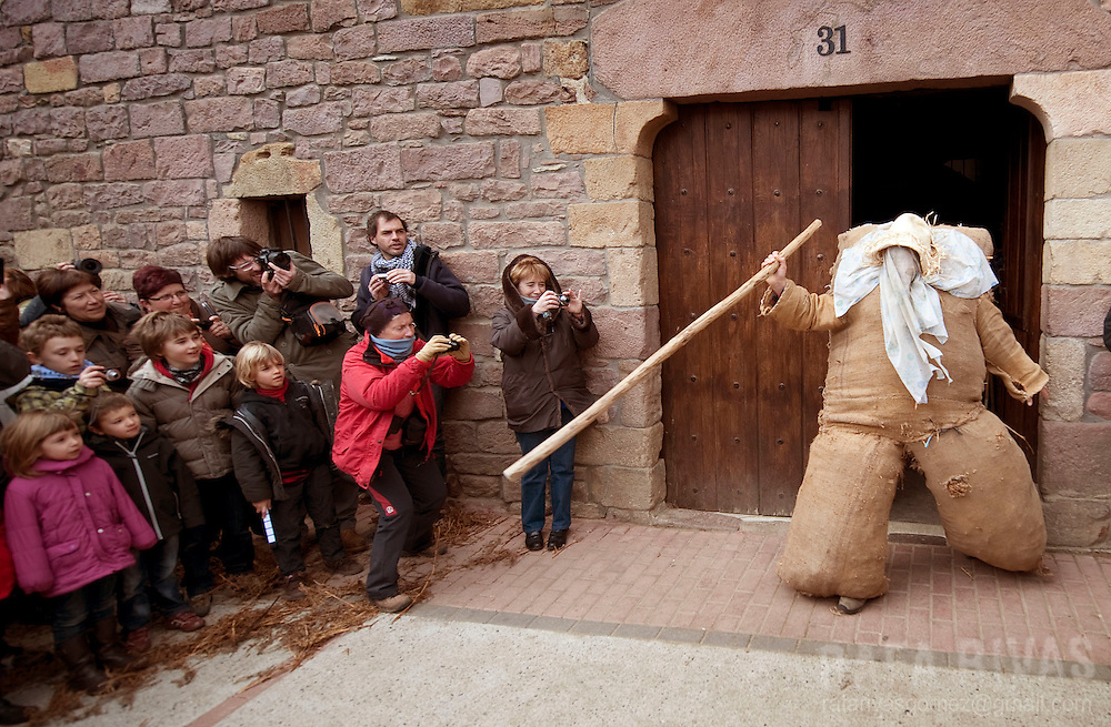 Ziripot comes out from a house during the ancient carnival of Lantz, in North of Navarra province in Spain, on March 8, 2011. PHOTO/ RAFA RIVAS