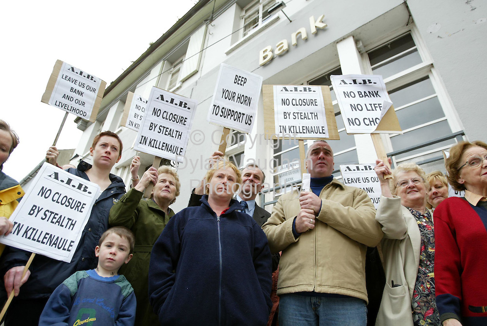 18/6/2002 Irish Independent News.Protesters pictured yesterday outside the Allied Irish Bank in Killenaule county Tipperary..Picture Dylan Vaughan