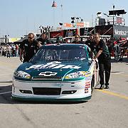 Sprint Cup Series driver Dale Earnhardt Jr. (88) gets help into his garage at Daytona International Speedway on February 18, 2011 in Daytona Beach, Florida. (AP Photo/Alex Menendez)