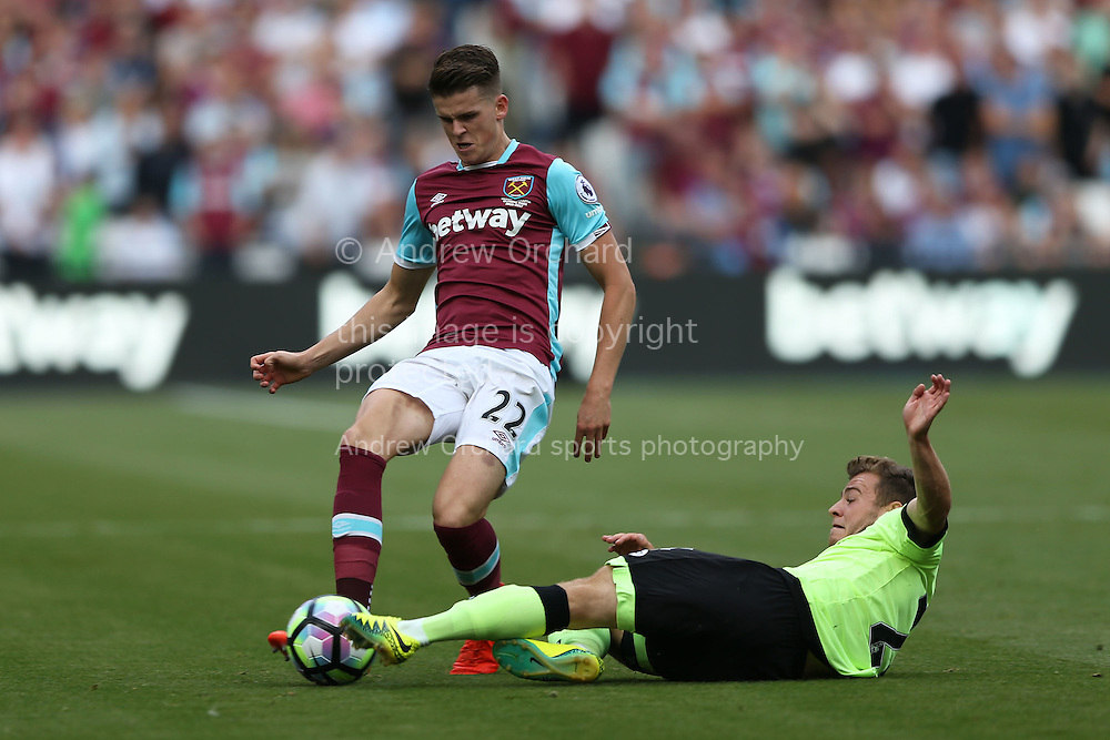 Ryan Fraser of Bournemouth intercepts Sam Byram of West Ham United. Premier league match, West Ham Utd v AFC Bournemouth at the London Stadium, Queen Elizabeth Olympic Park in London on Sunday 21st August 2016.<br /> pic by John Patrick Fletcher, Andrew Orchard sports photography.