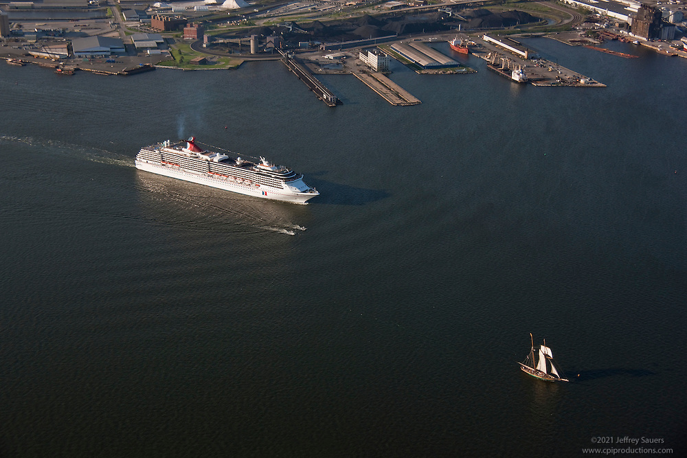 Cruise Ship Carnival Pride with the Pride of Baltimore II departing the Maryland Cruise Terminal