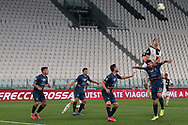 Juventus's Portuguese striker Cristiano Ronaldo climbs on the shoulders of Lecce's Italian defender Luca Rossettini in an attempt to win a header during the Serie A match at Allianz Stadium, Turin. Picture date: 26th June 2020. Picture credit should read: Jonathan Moscrop/Sportimage