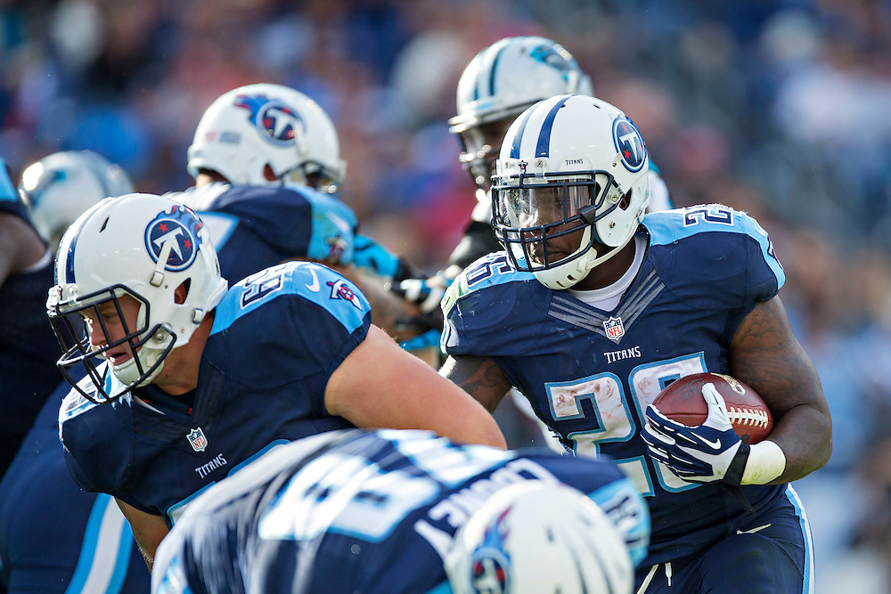NASHVILLE, TN - NOVEMBER 15:  Antonio Andrews #26 runs the ball behind the blocking of Andy Gallik #69 of the Tennessee Titans during a game against the Carolina Panthers at Nissan Stadium on November 15, 2015 in Nashville, Tennessee.  (Photo by Wesley Hitt/Getty Images) *** Local Caption *** Antonio Andrews; Andy Gallik