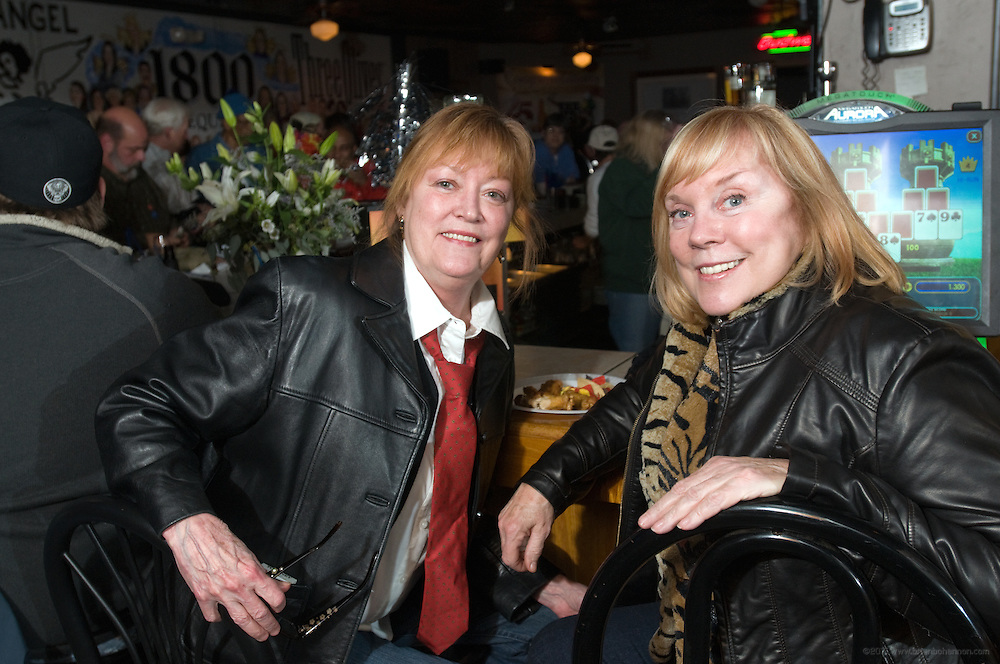 Regulars Rosie Robinson, left, and Eileen Robbins at the 25th anniversary party for the The Back Door and The Back Burner Grill, Thursday, Jan. 14, 2010 in Louisville, Ky. (Photo by Brian Bohannon)