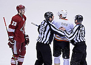 Mar. 2, 2013; Glendale, AZ, USA; NHL linesmen Pierre Raceicot (65) and Vaughan Rody (73) hold back Anaheim Ducks forward Ryan Getzlaf (15) from  Phoenix Coyotes defenseman Oliver Ekman-Larsson (23) in overtime at Jobing.com Arena. The Coyotes defeated the Ducks in a shootout 5-4. Mandatory Credit: Jennifer Stewart-USA TODAY Sports