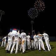 Mississippi players watch fireworks after an NCAA college baseball game against Georgia in Oxford, Miss., Friday, May 9, 2014. Mississippi won 12-2. (Photo/Thomas Graning)