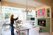 The Portland, Oregon home of Wendy Burden, author of  the memoir, Dead End Gene Pool. Ms. Burden arranges camelliea flowers.