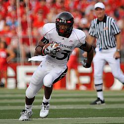 Sep 7, 2009; Piscataway, NJ, USA; Cincinnati running back Isaiah Pead (23) runs upfield during the first half of Rutgers 47-15 loss to Cincinnati in NCAA college football at Rutgers Stadium.