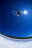 Skier performing flip on mountain