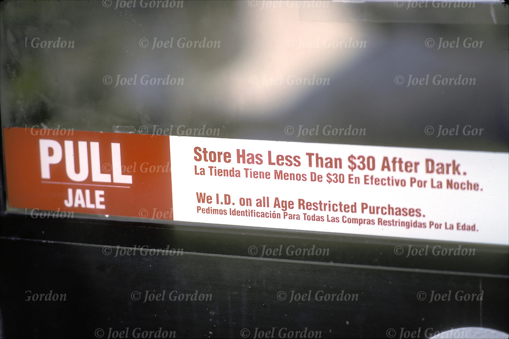 "Bilingual?Employee Cannot Open Safe. ""Store Has Less Than $30 After Dark"" and ""We I.D. on all Age Restricted Purchases"", crime prevention sign on store door, used to deter crime as well as gather evidence of a crime after offense as been committed"