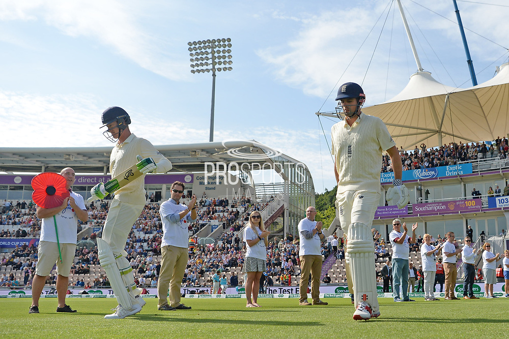 Keaton Jennings and Alastair Cook of England walk out to bat during the first day of the 4th SpecSavers International Test Match 2018 match between England and India at the Ageas Bowl, Southampton, United Kingdom on 30 August 2018.