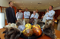 OUDTSHOORN, SOUTH AFRICA - MAY-1-2004 - Philippe Capelle ( far left) gives Marc Verwilghen , Belgian Minister of Development and Cooperation (far right) and his delegation, a tour of his enterprise, the Ostrich Leather World store and Ostrich Farm in Oudtshoorn , South Africa . Capelle is from Ardooie, Belgium in West Flanders and moved to South Africa permanently three years ago. (PHOTO © JOCK FISTICK)...<br />