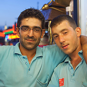 "Fish sandwich vendors in Istanbul, Turkey. In the evening in Istanbul, brightly lit fish boats beckon with a promise of a savory treat. For about a century, fishermen have been bringing their catch from the Bosphorus and the Sea of Marmara to Istanbul's Galata Bridge over the Golden Horn for sale. Shouting: ""Balık ekmek! Balık ekmek!"" (Fish in bread! Fish in bread!) a lively scene unfolds bt the water."