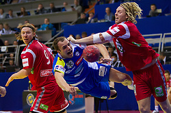 Uros Zorman of Slovenia vs Erlend Mamelund of Norway during handball match between Norway and Slovenia in Preliminary Round of 10th EHF European Handball Championship Serbia 2012, on January 16, 2012 in Millennium Center, Vrsac, Serbia. Norway defeated Slovenia 29-28. (Photo By Vid Ponikvar / Sportida.com)