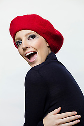 Young Woman in Red Beret Smiling