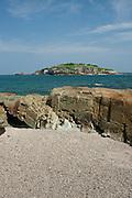 Rocky sea bed in low tide at Isla Pacheca shore. Las Perlas Archipelago, Panama Province, Panama, Central America.