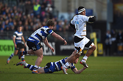 Wasps number 8 Nathan Hughes escapes the clutches of Bath Rugby's Chris Cook and Nick Auterac - Photo mandatory by-line: Paul Knight/JMP - Mobile: 07966 386802 - 10/01/2015 - SPORT - Rugby - Bath - The Recreation Ground - Bath Rugby v Wasps - Aviva Premiership