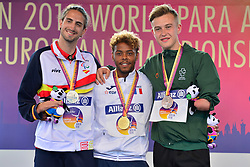 Medalists from left to right Daniel Perez Martinez, ESP, Silver, Alexandre Dipoko-Ewanel, FRA, Gold, Jordan, IRE, Bronze in the T47 High Jump at the Berlin 2018 World Para Athletics European Championships