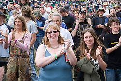 Crowd listening and dancing to band of musicians playing on stage at the Cropredy Festival  Fairport's Cropredy Convention  2005
